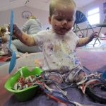 Baby doing Messy Play